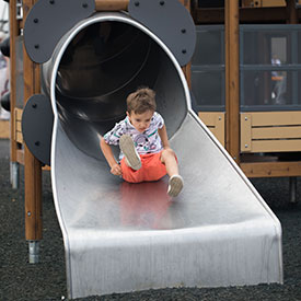Boy on a tube slide