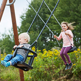Children playing on playground swings