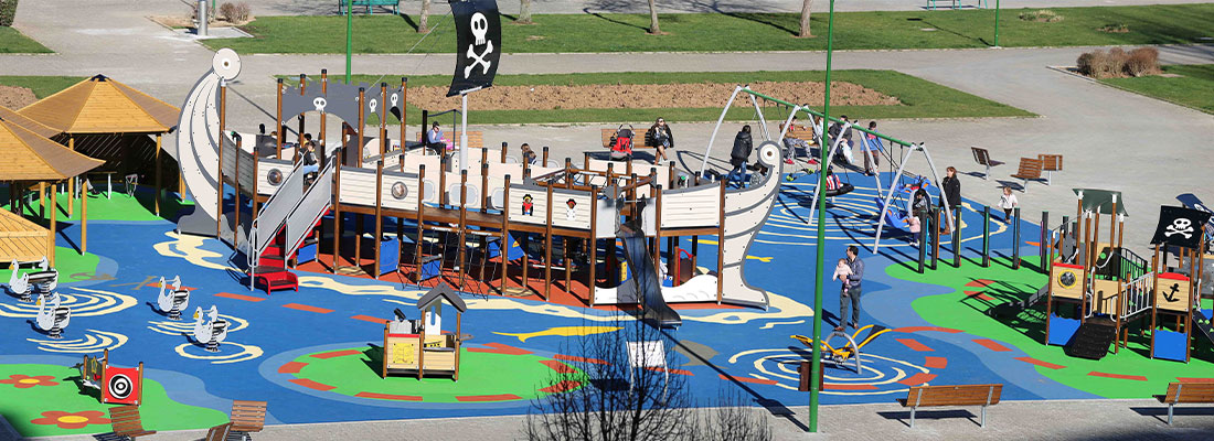 Inclusive playground with ship themed multi play unit in Spain