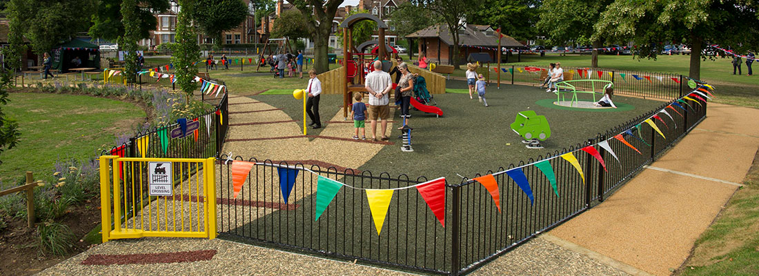 Playground with fencing as boundary and a yellow gate