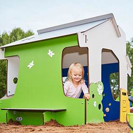 Girl playing on a playground play house